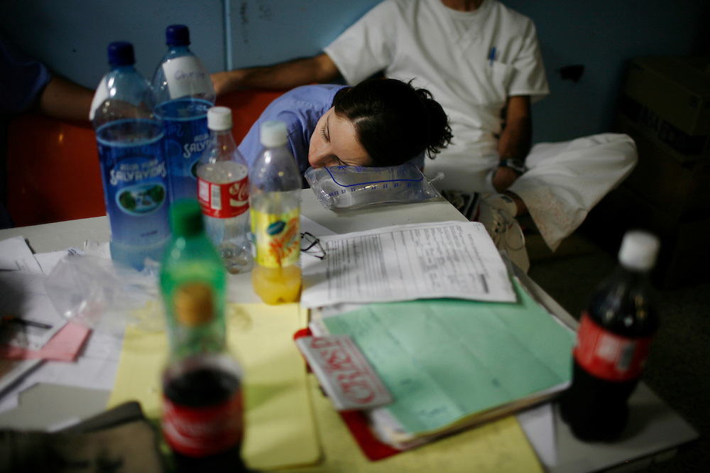 A medicine resident takes a nap on top of a serum in the emergency of  the San Juan de Dios hospital, Guatemala City, Saturday, May 15, 2010. (AP Photo/Rodrigo Abd)