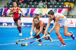 The Netherlands Naomi Van As is tackled by Georgina Oliva of Spain. Spain v The Netherlands - Unibet EuroHockey Championships, Lee Valley Hockey & Tennis Centre, London, UK on 23 August 2015. Photo: Simon Parker