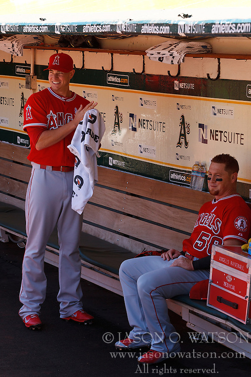 OAKLAND, CA - JUNE 21:  Garrett Richards #43 of the Los Angeles Angels of Anaheim and Kole Calhoun #56 talk in the dugout before the game against the Oakland Athletics at O.co Coliseum on June 21, 2015 in Oakland, California. The Oakland Athletics defeated the Los Angeles Angels of Anaheim 3-2. (Photo by Jason O. Watson/Getty Images) *** Local Caption *** Garrett Richards; Kole Calhoun