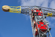 The hotel built inside a dockside CRANE ... where guests can enjoy a picnic in the top cabin<br /> <br /> This thrilling hotel in Harlingen, Netherlands, will provide a novel sleeping experience for guests if they have the head for heights to stay there.<br /> <br /> It is the second crane hotel to open in Holland, with guests bungee jumping off the top of its twin, the Faralda Crane Hotel in Amsterdam.<br /> <br /> A genuine dockside crane is converted here into a surprisingly luxurious getaway, or rather getup, with the old machine room transformed into a striking bedroom for two. <br /> <br /> They said it couldn't be done. And there were many hurdles that nearly prevented this mad concept from getting off the ground, but against the odds it succeeded. This then is a property of uncompromising character; a design hotel that pushed the boundaries of engineering to its limits.<br /> <br /> A spokesperson for the hotel said: 'This is a genuine dockside crane which has been the recipient of intelligent engineering and dedicated devotion rarely seen in a private home - let alone in a hotel property'.<br /> <br /> 'It is an out of this world property - staying here guarantees you stories to tell your friends'.<br /> <br /> The crane's flashy exterior – painted red, yellow and blue – is anything but subtle, but inside it's fascinatingly functional. There's no reception room or lounge and the lack of communal space means there are few opportunities for aesthetic assertions; the rickety lifts certainly aren't canvases for creative touches, but the suites they deliver you to are another story.<br /> <br /> All suites are equipped with the usual mod cons - coffee machines, kettles, minibars, televisions and music streaming devices - while wetrooms boast rainforest showers and porthole windows, which allow you to admire Amsterdam while conditioning your hair.<br /> <br /> Every room has spectacular views and because the crane moves in the wind guests often wake up with diffe