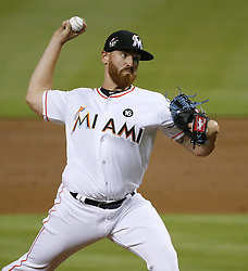 April 10, 2017 - Miami, FL, USA - Miami Marlins pitcher Dan Straily works during the third inning against the Atlanta Braves at Marlins Park in Miami on Tuesday, April 11, 2017. (Credit Image: © David Santiago/TNS via ZUMA Wire)