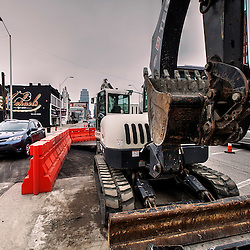 Utility alterations and preparations for installation of Kansas City streetcar construction.