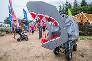 Henham Park, Suffolk, 21 July 2019. Trolley beast, adapted by a visitor, in the childrens area. Spoon art in the childrens area. The 2019 Latitude Festival.