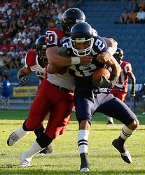 09.07.2011, UPC Arena, Graz, AUT, American Football WM 2011, Group B, Frankreich (FRA) vs Kanada (CAN), im Bild Paul Durand   (France, #12, QB ) gets stopped by Steve Faoro (Canada, #50, LB)// during the American Football World Championship 2011 Group B game, France vs Canada, at UPC Arena, Graz, 2011-07-09, EXPA Pictures © 2011, PhotoCredit: EXPA/ E. Scheriau
