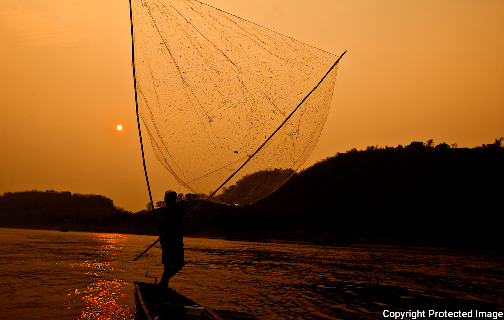 net fishing on the Mekong River, Luang Prabang, Lao