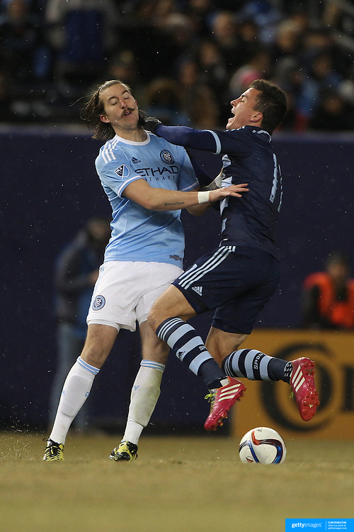 Jeb Brovsky, NYCFC, (left) and Bernardo Anor, Sporting KC, collide during the New York City FC Vs Sporting Kansas City, MSL regular season football match at Yankee Stadium, The Bronx, New York,  USA. 27th March 2015. Photo Tim Clayton