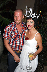 Designer ALEXANDER MCQUEEN and ISABELLA BLOW at the launch of 'Blow Lips' a new lipstick by Isabella Blow and MAC Makeup held at the the Blow de la Barra Gallery, 35 Heddon Street, London on 7th September 2005.<br />