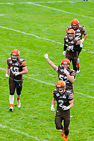 KELOWNA, BC - SEPTEMBER 8: Robie Holland #72, Jonah Williams #34, Dawson Puk #49, Jack Proskow #52 and Garrett Cape #2 of Okanagan Sun return to the sideline against the Langley Rams at the Apple Bowl on September 8, 2019 in Kelowna, Canada. (Photo by Marissa Baecker/Shoot the Breeze)
