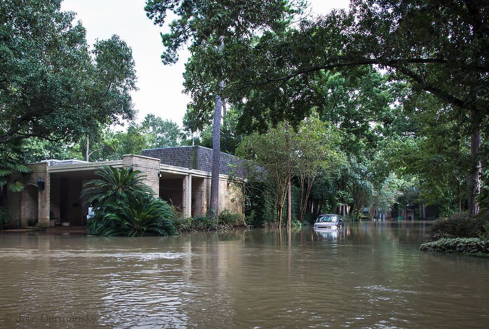 Days after Hurricane Harvey first made landfall in Texas, the Woodlands ll subdivision off Gessner  Road and Bayou Shadows, in Houston, Texas remained underwater. The flooding in this part of Houton was impacted by Harvey's rainstomr and  water released from the  Addicks Dam.  When the Addicks Reservoir started to over flow the U.S. Army Corps of Engineers began releasing water from the Addicks Dam, which had already started to overflow.