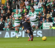 Dundee&rsquo;s Riccardo Calder hits a pass despite the challenge of Celtic&rsquo;s Saidy Janko  - Celtic v Dundee - Ladbrokes Premiership at Celtic Park<br /> <br /> <br />  - &copy; David Young - www.davidyoungphoto.co.uk - email: davidyoungphoto@gmail.com