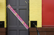 A child's fifth birthday banner has been pasted diagonally to the door of a pub on the Rockingham Estate in the London borough of Southwark, England. Coloured pink for a young girl's celebration, the banner stretches across the door of the family's local pub, painted yellow and red. Rockingham is located in south London near the Elephant and Castle. Notorious for youth issues including gangs and knife crime where 12-year-olds are seen holding knives in broad daylight. For families with young children this would be an intimidating community in which to live.