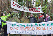UNITED KINGDOM, London: 02 February 2016 Protester Lewis Schaffer (centre), from the Save Southwark Woods campaign, is supported by other campaigners as he chains himself to a tree in Camberwell Old Cemetery. Save Southwark Woods are protesting about tree felling in the cemetery, which they claim is on consecrated and protected land. Rick Findler / Story Picture Agency