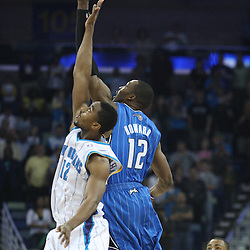 18 February 2009: Orlando Magic center Dwight Howard (12) and New Orleans Hornets center Hilton Armstrong (12) jump for the opening tip during a NBA basketball game between the Orlando Magic and the New Orleans Hornets at the New Orleans Arena in New Orleans, Louisiana.
