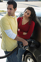 Couple pumping gas