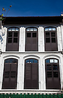 Restored shophouse windows are an attractive and colourful traditional architectural treat in Singapore's Chinatown district.