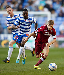 Derby Forward Jamie Ward (NIR) gets away from Reading Midfielder Hope Akpan (ENG) and Defender Alex Pearce (IRL)  - Photo mandatory by-line: Rogan Thompson/JMP - 07966 386802 - 15/09/2014 - SPORT - FOOTBALL - Madejski Stadium - Reading - Reading v Derby County - Sky Bet Football League Championship.