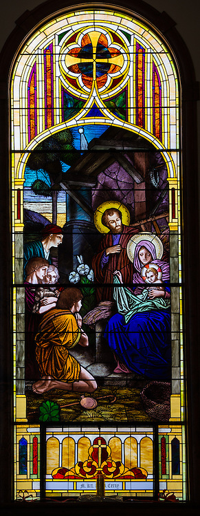 Stained glass image from St. Joseph Church in Kellnersville, Wis., showing Holy Family at Jesus' birth. (Sam Lucero photo)
