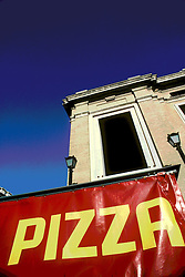 Bright red and yellow pizza sign over Italian restaurant. Abstract design image