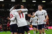 Goal - Mohamed Salah (11) of Liverpool celebrates after he scores a goal to give a 0-3 lead with Andrew Robertson (26) of Liverpool and Alex Oxlade-Chamberlain (15) of Liverpool during the Premier League match between Bournemouth and Liverpool at the Vitality Stadium, Bournemouth, England on 7 December 2019.