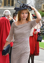 A guest arrive for the wedding of Princess Eugenie to Jack Brooksbank at St George's Chapel in Windsor Castle