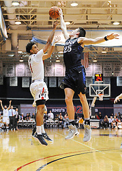 MOON TOWNSHIP, PA - NOVEMBER 11:  Isaiah Still #1 of the Robert Morris Colonials has his shot blocked by AJ Brodeur #25 of the Pennsylvania Quakers in the first half during the game on November 11, 2016, at the Charles L. Sewall Center in Moon Township, Pennsylvania. (Photo by Justin Berl)