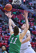 SAN DIEGO, CA - MARCH 18:  West Virginia Mountaineers forward Teddy Allen (13) shoots a layup against Marshall Thundering Herd forward Ajdin Penava (11) during a second round game of the Men's NCAA Basketball Tournament at Viejas Arena in San Diego, California. West Virginia won 94-71.  (Photo by Sam Wasson)