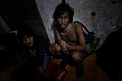 Addicts in an abandoned building, Phnom Penh, Cambodia.<br />