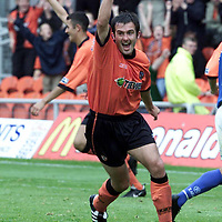 Dundee Utd v St Johnstone<br />David Hannah who powered a shot at goal which was deflected in by Hasney Aljofree (pictured back) celebrate the goal<br /><br />Pic by Graeme Hart<br />Copyright Perthshire Picture Agency<br />Tel: 01738 623350 / 07990 594431