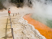 Green and orange Champagne Pool steams at Wai-O-Tapu Thermal Wonderland, North Island, New Zealand