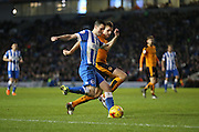 Brighton winger, Jamie Murphy (15) whips in a cross during the Sky Bet Championship match between Brighton and Hove Albion and Wolverhampton Wanderers at the American Express Community Stadium, Brighton and Hove, England on 1 January 2016.