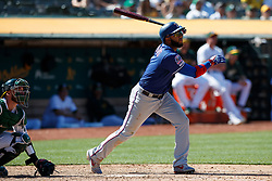 OAKLAND, CA - JULY 28:  Elvis Andrus #1 of the Texas Rangers at bat against the Oakland Athletics during the ninth inning at the RingCentral Coliseum on July 28, 2019 in Oakland, California. The Oakland Athletics defeated the Texas Rangers 6-5. (Photo by Jason O. Watson/Getty Images) *** Local Caption *** Elvis Andrus