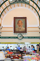 A portrait of Ho Chi Minh hangs in the Central Post Office in Ho Chi Minh City, Vietnam