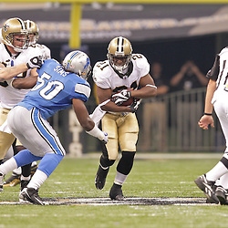 2009 September 13: New Orleans Saints running back Mike Bell (21) runs as Detroit Lions linebacker Ernie Sims (50) pursues during a 45-27 win by the New Orleans Saints over the Detroit Lions at the Louisiana Superdome in New Orleans, Louisiana.