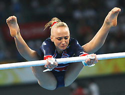 US's Nastia Liukin competes on the uneven bars of artistic gymnastics apparatus finals during the Olympic games in Beijing, China, 18 August 2008. Liukin won the silver for the event.