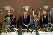 16478Bicentennial Closing Ceremony 5/19/04 : Photos by Johnny Hanson..Robert Glidden, Ohio University president, and his Bicentennial Fundraising Team, look through an ice sculpture at Walter Hall during the closing ceremonies of the Ohio University Bicentennial year.