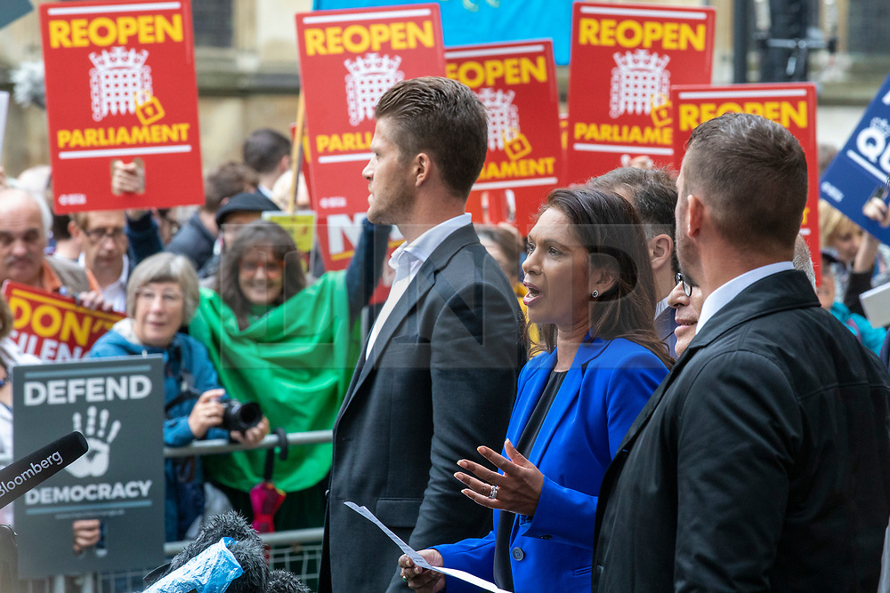 © Licensed to London News Pictures. 24/09/2019. London, UK. Gina Miller (2-R) speaks outside the Supreme Court in London after judges ruled that Prime Minister Boris Johnson's suspension of Parliament was unlawful. Photo credit: Rob Pinney/LNP