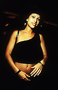 A mixed-race woman wearing black top, Miami, U.S.A, 1990s.