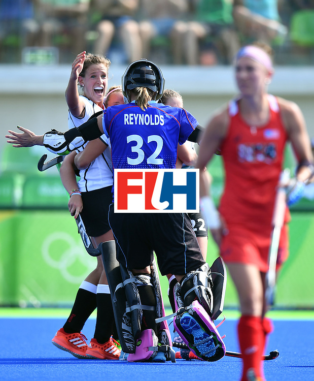 Germany's players celebrate at the end of the the women's quarterfinal field hockey USA vs Germany match of the Rio 2016 Olympics Games at the Olympic Hockey Centre in Rio de Janeiro on August 15, 2016. / AFP / MANAN VATSYAYANA        (Photo credit should read MANAN VATSYAYANA/AFP/Getty Images)