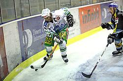 Tomaz Vnuk of Olimpija and Philipp Lukas of Linz at ice hockey match ZM Olimpija vs Liwest Linz in sixth round of semi-final of Ebel League (Erste Bank Eishockey Liga),  on March  9, 2008 in Arena Tivoli, Ljubljana, Slovenia. Win of ZM Olimpija 2:0, ZM Olimpija qualified in finals. (Photo by Vid Ponikvar / Sportal Images)