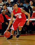 5 MARCH 2011 -- NORMANDY, Mo -- Chaminade College Prep basketball player Tevin Evans (12) drives the baseline during the MSHSAA Class 5 boys basketball quarterfinals between the Red Devils and McCluer North High Schoo at Mark Twain Hall on the University of Missouri - St. Louis campus in Normandy, Mo. Saturday, March 5, 2011. The Stars upset the Red Devils 57-56 to advance to MSHSAA semifinals. Image © copyright 2011 Sid Hastings.