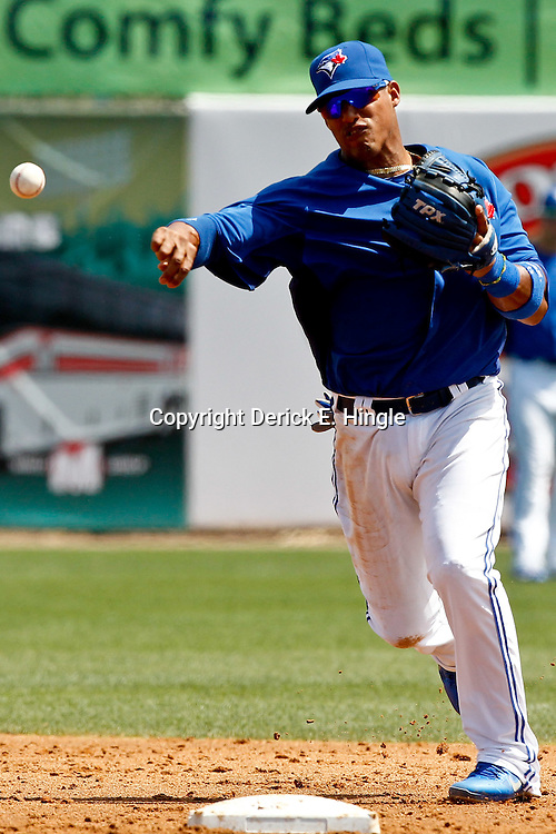 March 16, 2012; Dunedin, FL, USA; Toronto Blue Jays shortstop Yunel Escobar (5) against the Tampa Bay Rays during a spring training game at Florida Auto Exchange Stadium. Mandatory Credit: Derick E. Hingle-US PRESSWIRE