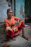 Woman sitting on Doorstep - Dharavi, Mumbai, India