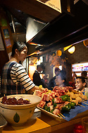 Yakatori waiting to be grilled at a restaurant in Omoide-yokocho, an alley of small eateries in Shinjuku, Tokyo, Honshu, Japan