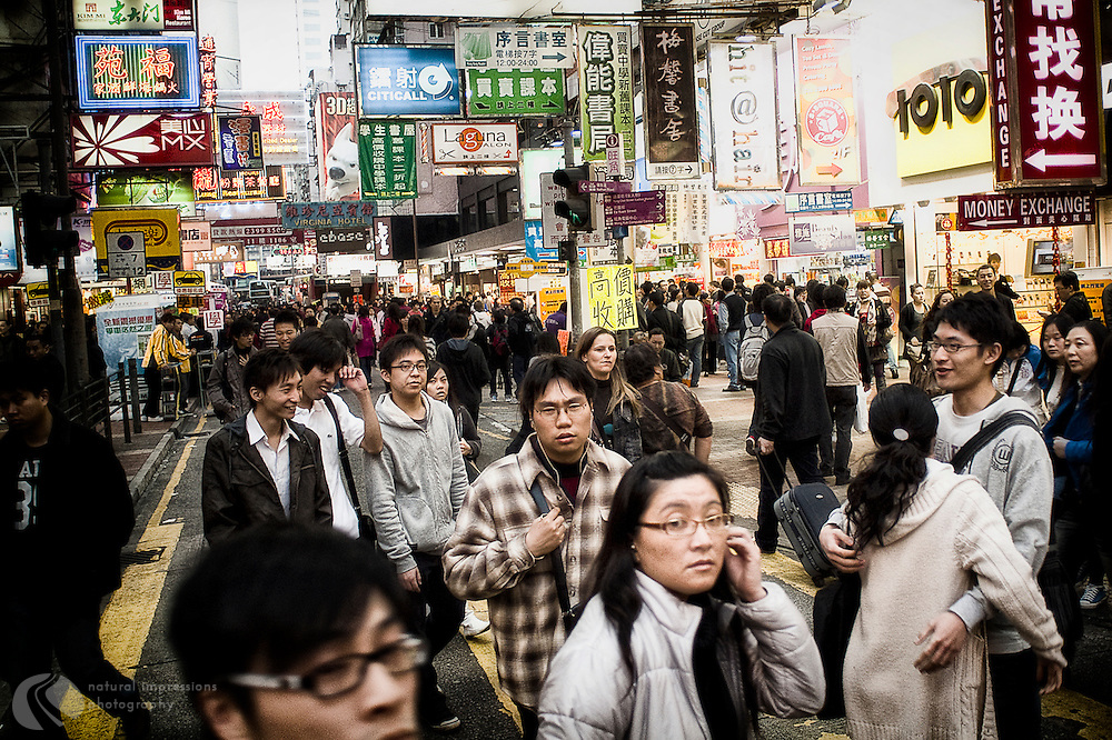 A sea of black hair,colorful signs and packed streets goes on for miles and miles in Hong Kong.