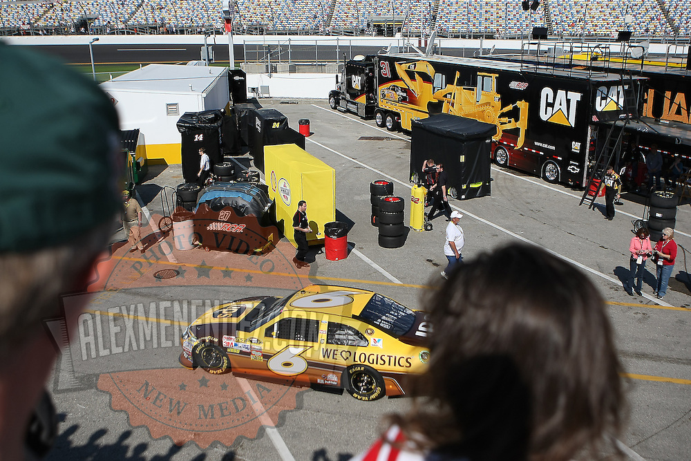 Fans watch as Sprint Cup Series driver David Ragan (6) exits the garage area at Daytona International Speedway on February 18, 2011 in Daytona Beach, Florida. (AP Photo/Alex Menendez)