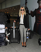 08.NOVEMBER.2012. LONDON<br /> <br /> UNA HEALY ALONG WITH BABY AOIFE BELLE, FRANKIE SANDFORD AND MOLLIE KING FROM THE SATURDAYS ARRIVING BACK AT HEATHROW AIRPORT ON A FLIGHT BACK FROM LA AFTER SPENDING 4 MONTHS AWAY. THE GIRLS THEN SAY AN EMOTIONAL GOODBYE TO EACHOTHER AND HAVE A GROUP HUG.<br /> <br /> BYLINE: EDBIMAGEARCHIVE.CO.UK<br /> <br /> *THIS IMAGE IS STRICTLY FOR UK NEWSPAPERS AND MAGAZINES ONLY*<br /> *FOR WORLD WIDE SALES AND WEB USE PLEASE CONTACT EDBIMAGEARCHIVE - 0208 954 5968*