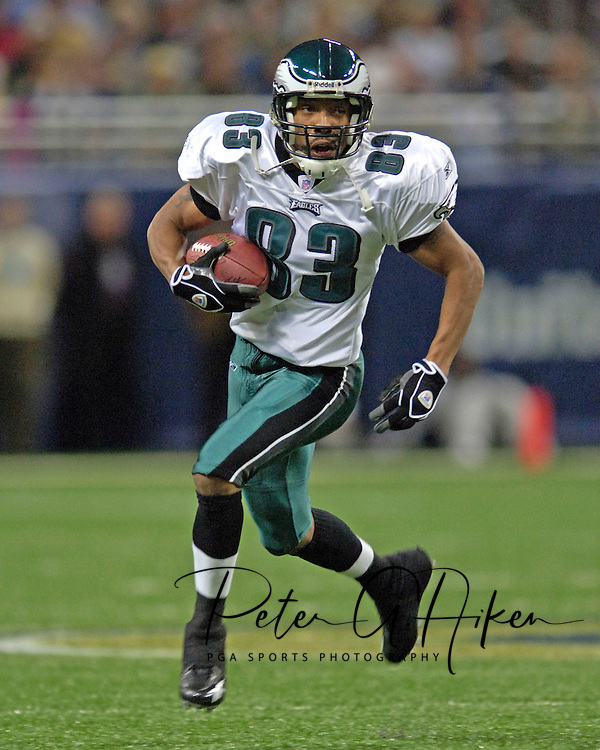 Philadelphia Eagles wide receiver Greg Lewis rushes up field after making a catch in the first half against the St. Louis Rams, at the Edward Jones Dome in St. Louis, Missouri, December 18, 2005.  The Eagles beat the Rams 17-16.