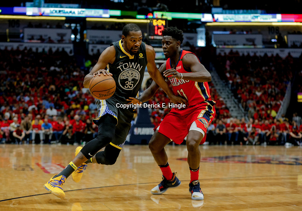 May 6, 2018; New Orleans, LA, USA; Golden State Warriors forward Kevin Durant (35) drives in against New Orleans Pelicans guard Jrue Holiday (11) during the second quarter in game four of the second round of the 2018 NBA Playoffs at the Smoothie King Center. Mandatory Credit: Derick E. Hingle-USA TODAY Sports