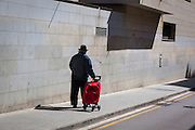Man with shopping trolley in Sant Cugat, Barcelona.
