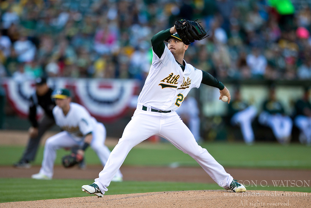 OAKLAND, CA - JULY 05:  Scott Kazmir #26 of the Oakland Athletics pitches against the Toronto Blue Jays during the first inning at O.co Coliseum on July 5, 2014 in Oakland, California. (Photo by Jason O. Watson/Getty Images) *** Local Caption *** Scott Kazmir